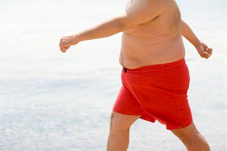 fat man exercising - Overweight man walking Stock Photo - Premium Royalty-Free, Code: 679-02996037