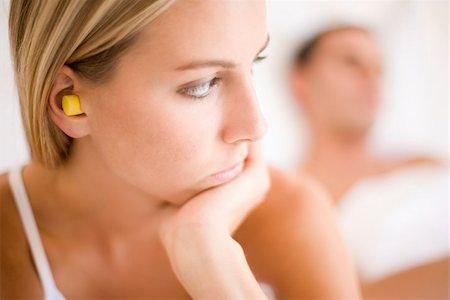 people having sex - Woman wearing earplugs Stock Photo - Premium Royalty-Free, Code: 679-02996204