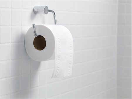 Toilet paper holder and roll. Stock Photo - Premium Royalty-Free, Code: 679-03298270