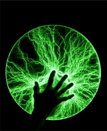 plasma - Photograph of so-called plasma disc producing bright green flashes. Different from a plasma sphere, a plasma disc consist of a flat glass plate containing a phosphor layer. Stock Photo - Premium Royalty-Free, Code: 679-03679378