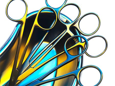 Surgical instruments in a dish. Stock Photo - Premium Royalty-Free, Code: 679-03680789
