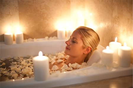 Woman relaxing in a bath. Stock Photo - Premium Royalty-Free, Code: 679-03681602