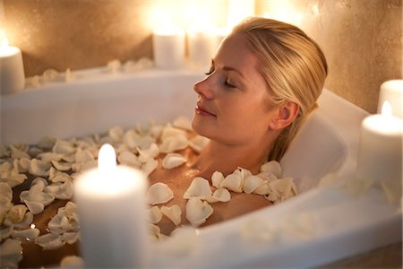Woman relaxing in a bath. Stock Photo - Premium Royalty-Free, Code: 679-03681603