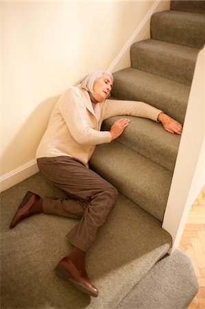 falling - Senior woman injured in fall down the stairs. Stock Photo - Premium Royalty-Free, Code: 679-03681662