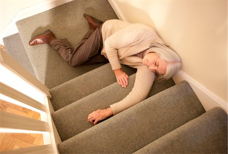falling - Senior woman injured in fall down the stairs. Stock Photo - Premium Royalty-Free, Code: 679-03681663
