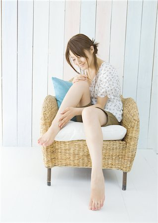 foot massage - Woman sitting in chair Stock Photo - Premium Royalty-Free, Code: 670-04249636