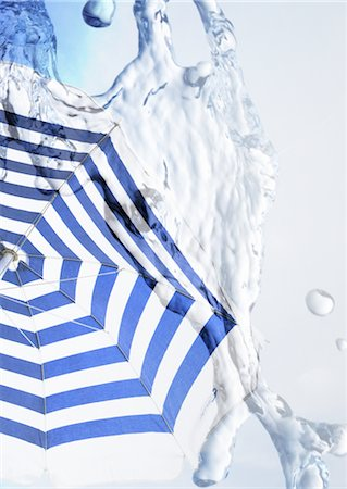 swirl - Parasol and water Stock Photo - Premium Royalty-Free, Code: 670-04249693