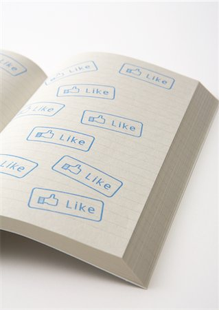 """Notebook with """"like"""" stamps Stock Photo - Premium Royalty-Free, Code: 670-05652656"""