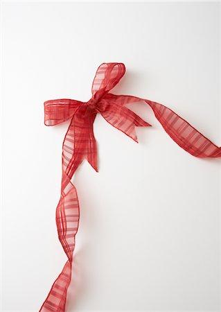 Red ribbon Stock Photo - Premium Royalty-Free, Code: 670-05652666