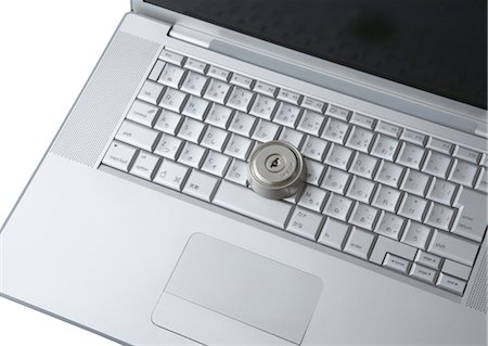 Computer keyboards with keyhole Stock Photo - Premium Royalty-Free, Code: 670-05652927