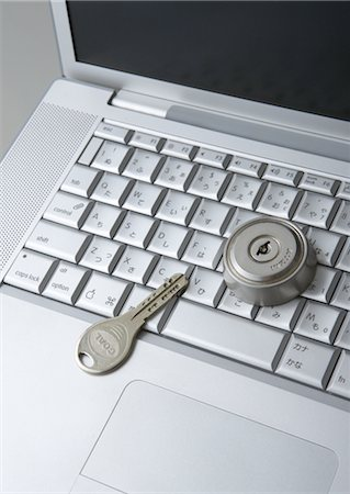 Computer keyboards with keyhole and key Stock Photo - Premium Royalty-Free, Code: 670-05652929