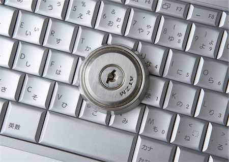 Computer keyboards with keyhole Stock Photo - Premium Royalty-Free, Code: 670-05652930