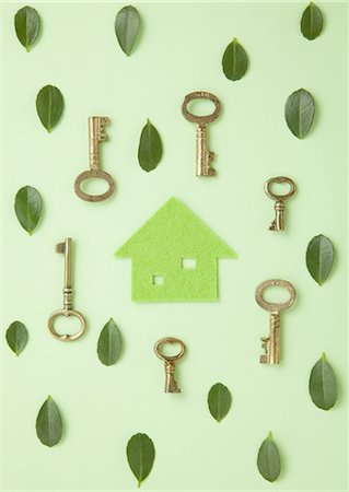 Eco house surrounded with leaves and keys Stock Photo - Premium Royalty-Free, Code: 670-06024358