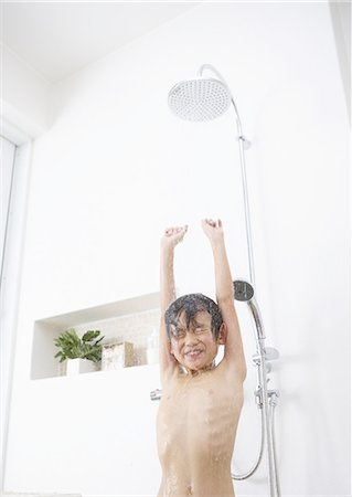 shower - Boy taking a shower Stock Photo - Premium Royalty-Free, Code: 670-06024981