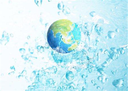 Globe and splashes of water Stock Photo - Premium Royalty-Free, Code: 670-06449990