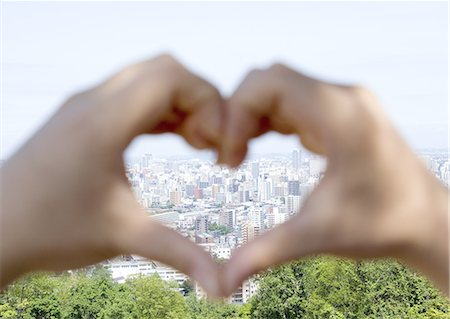 Cityscape in hands making a heart shape Stock Photo - Premium Royalty-Free, Code: 670-06450016