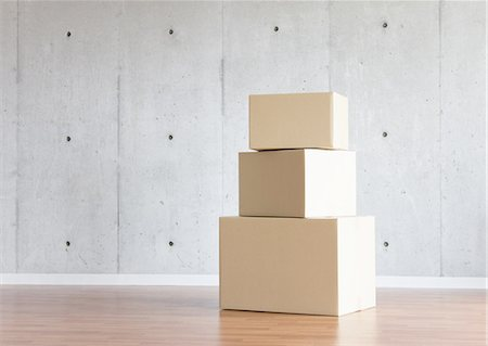 Concrete wall and cardboard boxes Stock Photo - Premium Royalty-Free, Code: 670-06450614
