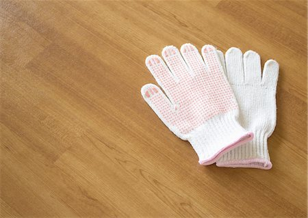 pair - Work gloves on a wooden floor Stock Photo - Premium Royalty-Free, Code: 670-06450625