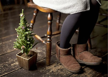 Christmas tree and woman's legs wearing ugg boots Stock Photo - Premium Royalty-Free, Code: 670-06450759