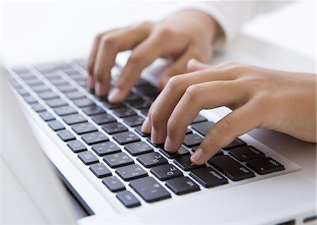 female hand - Hands typing on a laptop Stock Photo - Premium Royalty-Free, Code: 670-06451292