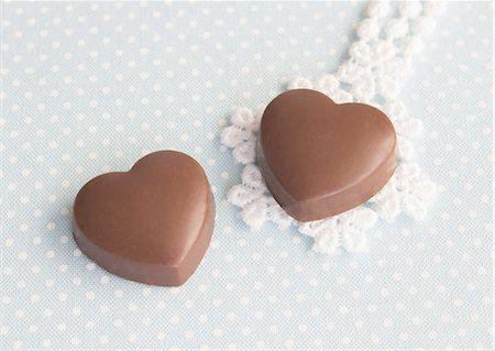 Heart-shaped chocolates Stock Photo - Premium Royalty-Free, Code: 670-06451347