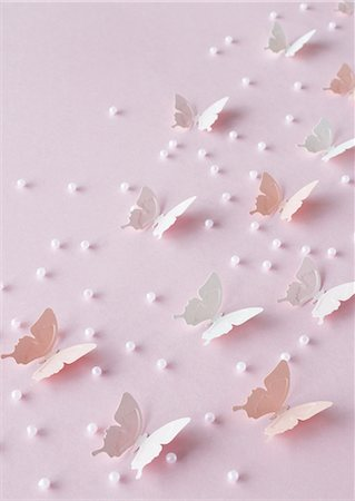 Pastel-colored butterflies and beads Stock Photo - Premium Royalty-Free, Code: 670-06824695