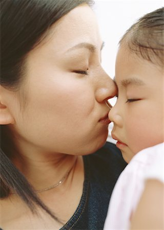 daughter kissing mother - Beloved daughter Stock Photo - Premium Royalty-Free, Code: 670-02114070