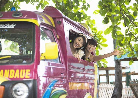 Women taking bus Stock Photo - Premium Royalty-Free, Image code: 670-02117848
