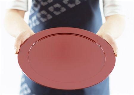 Red tray Stock Photo - Premium Royalty-Free, Code: 670-02110088