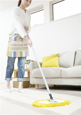 Woman mopping Stock Photo - Premium Royalty-Free, Code: 670-03484361