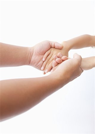 Parent and child holding hands Stock Photo - Premium Royalty-Free, Code: 670-03710172