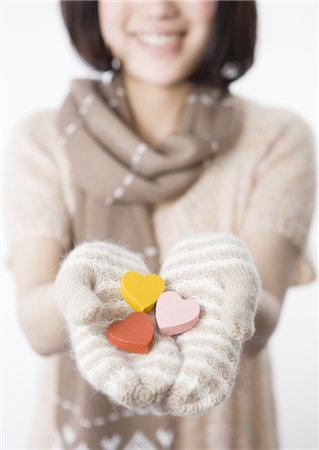 Woman holding wooden hearts Stock Photo - Premium Royalty-Free, Code: 670-03734372