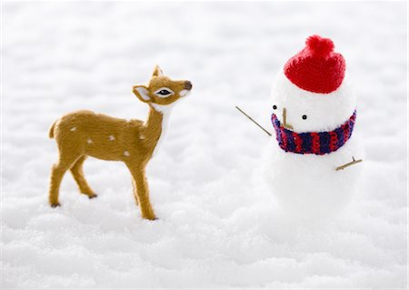 Snowman and fawn Stock Photo - Premium Royalty-Free, Code: 670-03734432