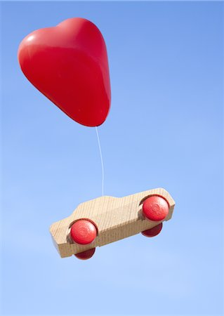 fly heart - Heart shaped balloons and wooden hot wheels Stock Photo - Premium Royalty-Free, Code: 670-03886177