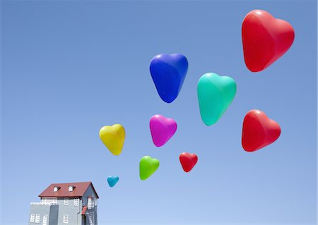 fly heart - Heart shaped balloons and miniature house Stock Photo - Premium Royalty-Free, Code: 670-03886200