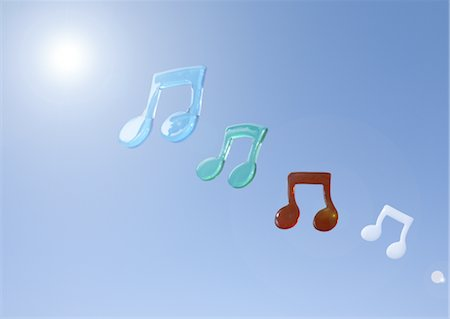 Musical notes floating in blue sky Stock Photo - Premium Royalty-Free, Code: 670-03886338