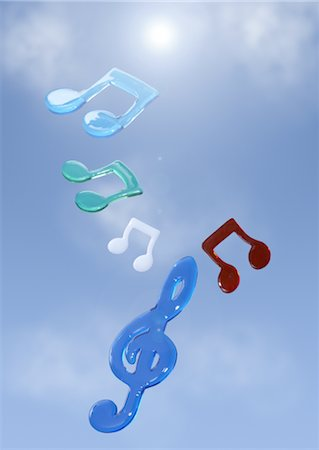 Musical notes floating in blue sky Stock Photo - Premium Royalty-Free, Code: 670-03886339