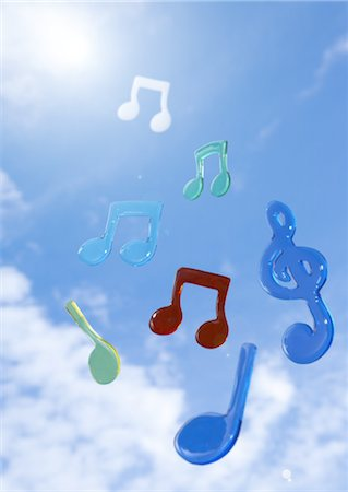 Musical notes floating in blue sky Stock Photo - Premium Royalty-Free, Code: 670-03886340