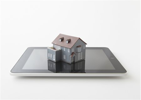 renting - Tablet PC and miniature model house Stock Photo - Premium Royalty-Free, Code: 670-03886465