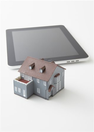 renting - Tablet PC and miniature model house Stock Photo - Premium Royalty-Free, Code: 670-03886470