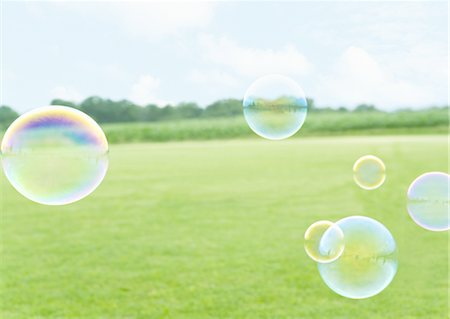 Grass field and bubbles Stock Photo - Premium Royalty-Free, Code: 670-03887049