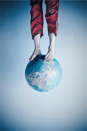 preteen feet - Feet and legs on globe Stock Photo - Premium Royalty-Free, Code: 673-06025417