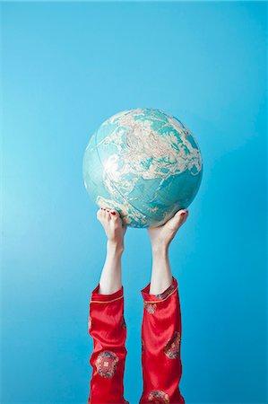preteen feet - Feet holding globe Stock Photo - Premium Royalty-Free, Code: 673-06025418