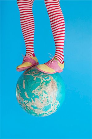 Legs in striped socks with colorful shoes on globe Stock Photo - Premium Royalty-Free, Code: 673-06025424