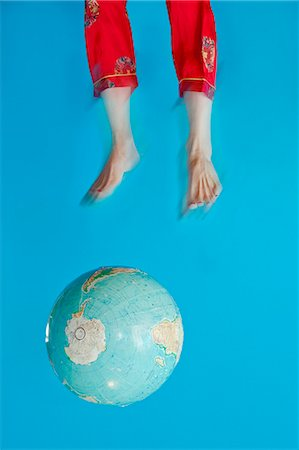 Globe and feet in air Stock Photo - Premium Royalty-Free, Code: 673-06025420