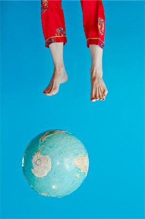 Globe and feet in air Stock Photo - Premium Royalty-Free, Code: 673-06025421