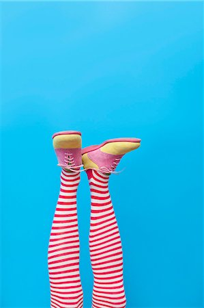 preteen feet - Legs in striped socks with colorful shoes Stock Photo - Premium Royalty-Free, Code: 673-06025422
