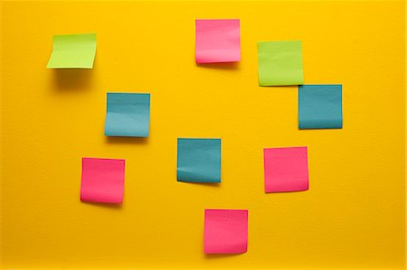 self adhesive note - Yellow wall with colorful post-its Stock Photo - Premium Royalty-Free, Code: 673-06025436