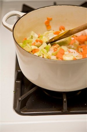 stove - White pot with vegetables on stove Stock Photo - Premium Royalty-Free, Code: 673-06025495