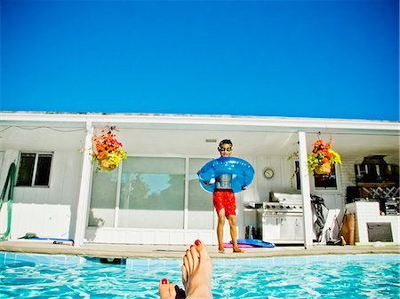 preteen feet - Boy in floaty standing next to pool Stock Photo - Premium Royalty-Free, Code: 673-06025523